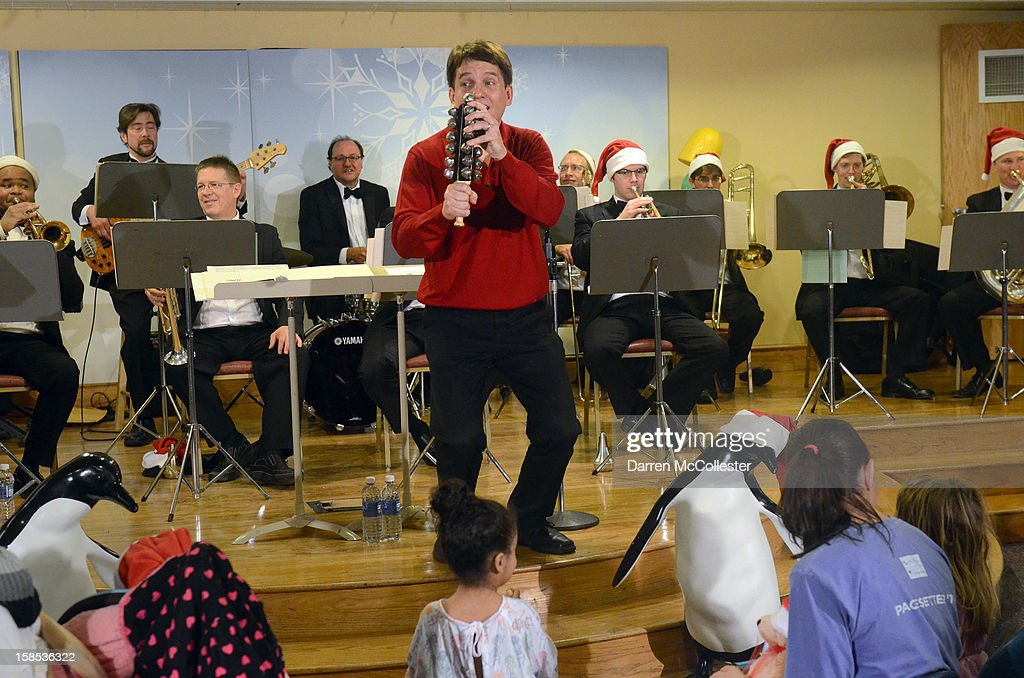 Conductor Keith Lockhart performs during the Boston Pops Holiday Concert at Boston Children's Hospital on December 18, 2012 in Boston, Massachusetts.