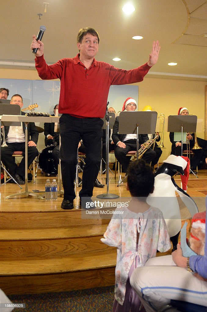 Conductor <a gi-track='captionPersonalityLinkClicked' href=/galleries/search?phrase=Keith+Lockhart+-+Orchestral+Conductor&family=editorial&specificpeople=4508918 ng-click='$event.stopPropagation()'>Keith Lockhart</a> performs during the Boston Pops Holiday Concert at Boston Children's Hospital on December 18, 2012 in Boston, Massachusetts.