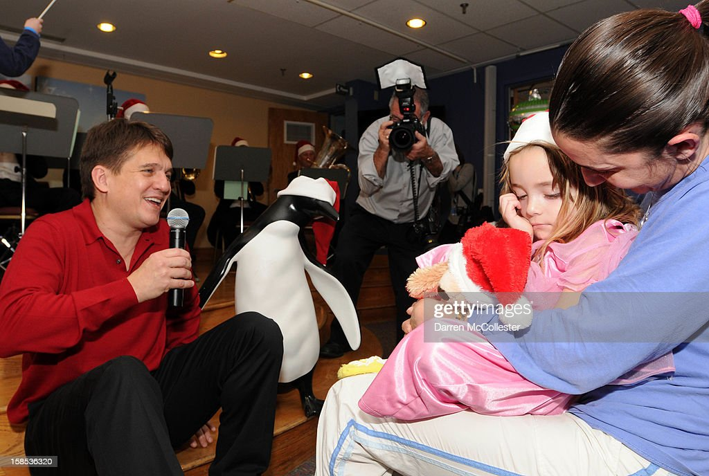 Conductor Keith Lockhart sings to Jacqlyn during the Boston Pops Holiday Concert at Boston Children's Hospital on December 18, 2012 in Boston, Massachusetts.