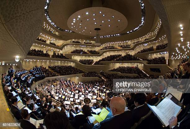 Conductor Kent Nagano Hamburg's philharmonic orchestra and the choir of Hamburg's opera perform in the Elbphilharmonie concert hall in Hamburg...