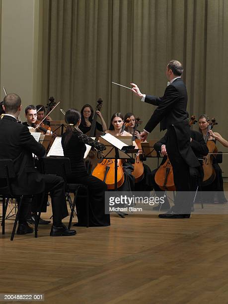 Conductor leading orchestra