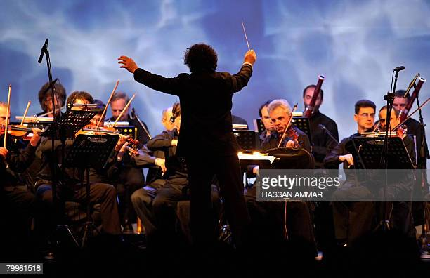 A conductor leads his orchestra during an entertainment break at the Jeddah Economic Forum in the Red Sea port city of Jeddah late February 23 2008...