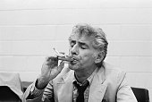 Conductor Leonard Bernstein plays a kazoo during a rehearsal of 'Mass' at the John F Kennedy Center for the Performing Arts A scene from 'Mass' which...
