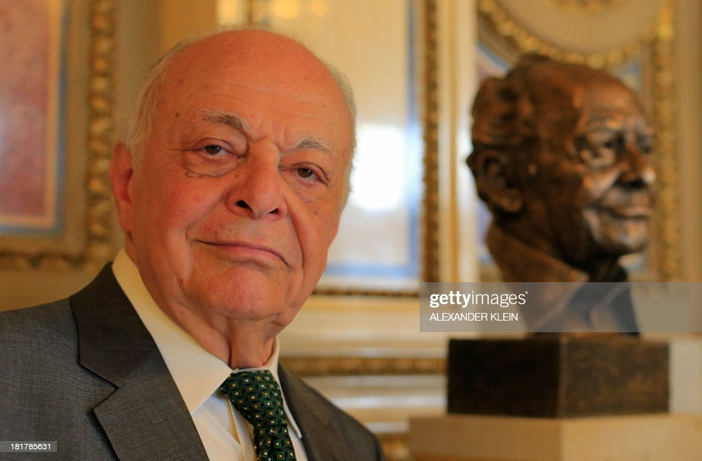 US conductor Lorin Maazel poses next to his bronze bust at the Vienna State Opera (Staatsoper) in Vienna on September 25, 2013. Maazel used to be the first American to become General Manager, Artistic Director and Principal Conductor of the Vienna State Opera between 1982 and 1984. His close association with the Vienna Philharmonic includes 11 internationally televised New Years Concerts from Vienna.