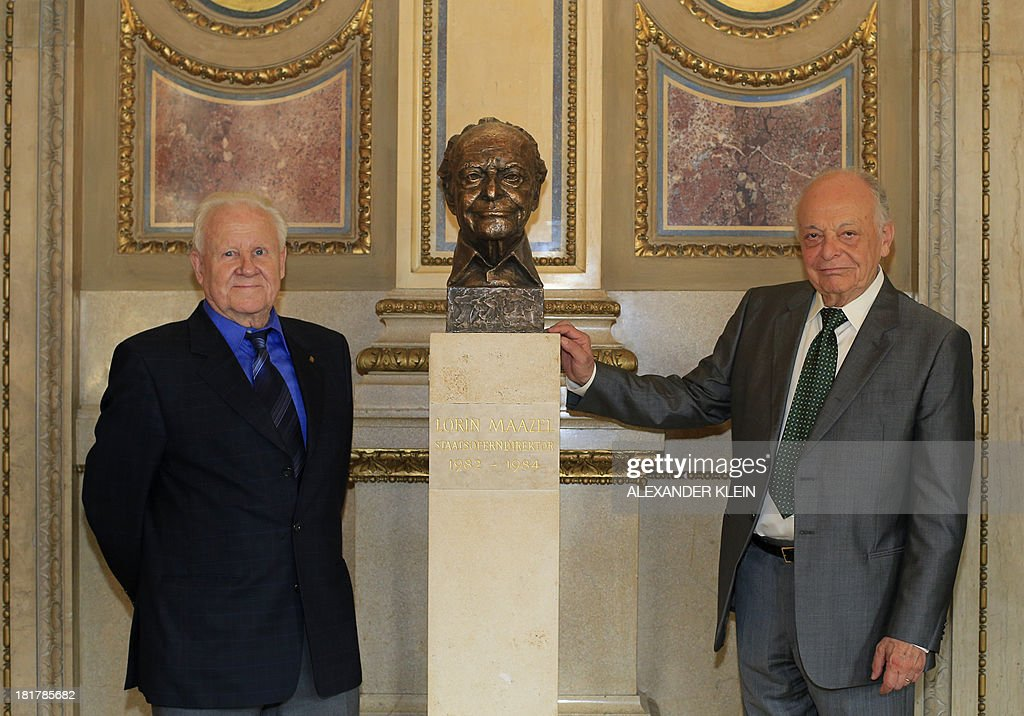 US conductor Lorin Maazel (R) poses with Austrian sculptor Helmut Millonig after unveiling his bronze bust at the Vienna State Opera (Staatsoper) in Vienna on September 25, 2013. Maazel used to be the first American to become General Manager, Artistic Director and Principal Conductor of the Vienna State Opera between 1982 and 1984. His close association with the Vienna Philharmonic includes 11 internationally televised New Years Concerts from Vienna.