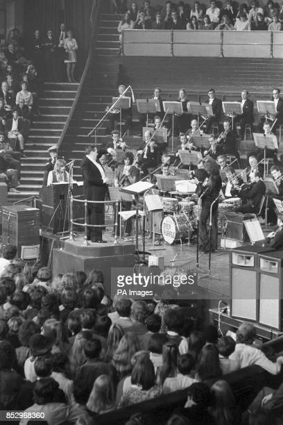 Conductor Malcolm Arnold conducts the rehearsal of Deep Purple's 'Concerto for Group and Orchestra' composed by the group's organist Jon Lord The...