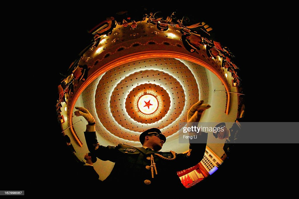 A conductor of a military band performs during a rehearsal before the opening session of the Chinese People's Political Consultative Conference in Beijing's Great Hall of the People on March 3, 2013 in Beijing, China. Over 2,000 members of the 12th National Committee of the Chinese People's Political Consultative, a political advisory body, are attending the annual session, during which they will discuss the development of China.