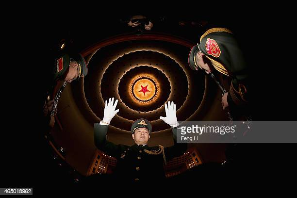 A conductor of a military band performs during a rehearsal before the opening session of the Chinese People's Political Consultative Conference at...