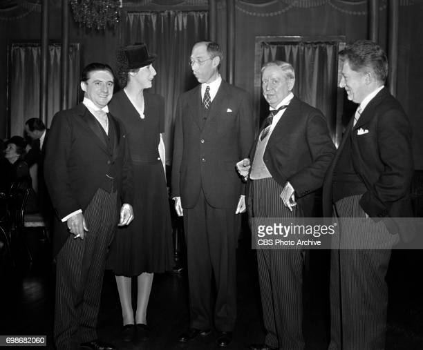 Conductor of the New York Philharmonic John Barbirolli and wife second from left in Chicago Illinois at a tea and reception at the English Speaking...