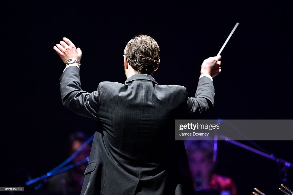 A conductor performs at Itzhak Perlman's concert Barclays Center on February 28, 2013 in New York City.