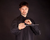 conductor on a black background with a big inspiration gets the job done
