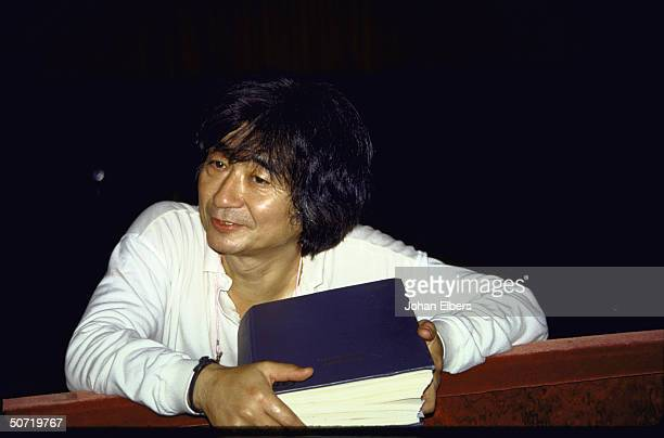 Conductor Seiji Ozawa leaning out of the orchestra pit at the Metropolitan Opera before an opera rehearsal