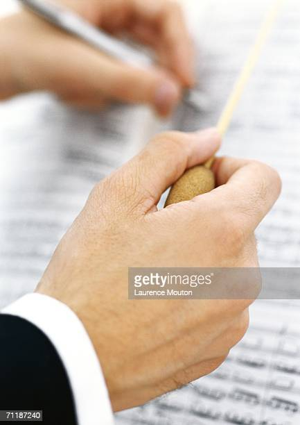 Conductor taking notes on sheet music