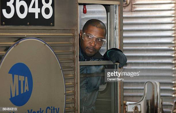 A conductor waits for passengers December 23 2005 in New York City After three days of strikes New York City subways and buses returned to service...