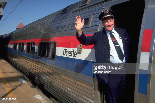 Conductor Waving From Train