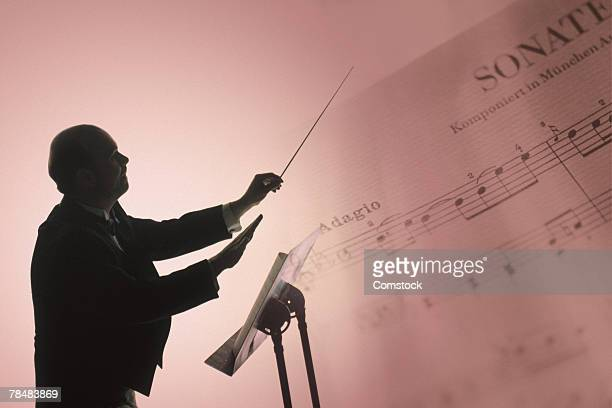 Conductor with sheet music