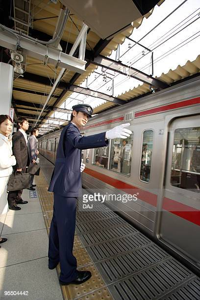 Conductor working at platform