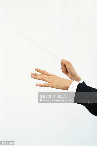 Conductor's hands with conductor's baton