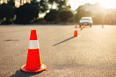 Cones for the examination, driving school concept. lesson for novice car drivers, test for beginner