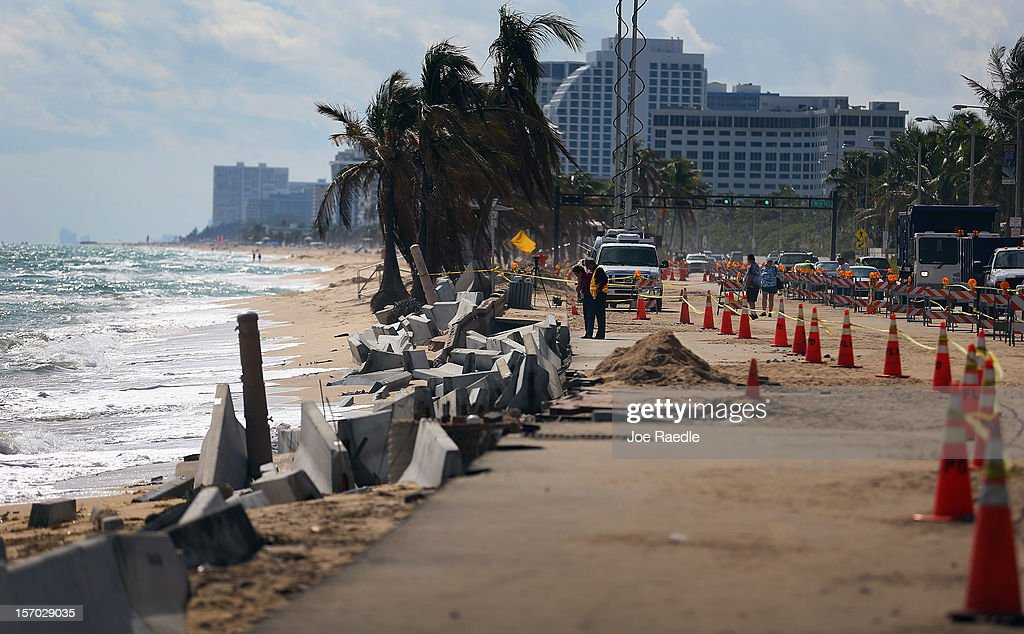 Cones mark off the damage caused by beach erosion along route A-1-A, making parts of it impassable to vehicles on November 27, 2012 in Fort Lauderdale, Florida. The beach was eroded away last month when Hurricane Sandy passed by to the east and now City officials are saying that the damage may preview what rising sea levels can mean for coastal communities throughout South Florida. Climate scientists predict sea levels in South Florida will rise by 1 foot by 2070, 2 feet by 2115, and 3 feet by 2150.