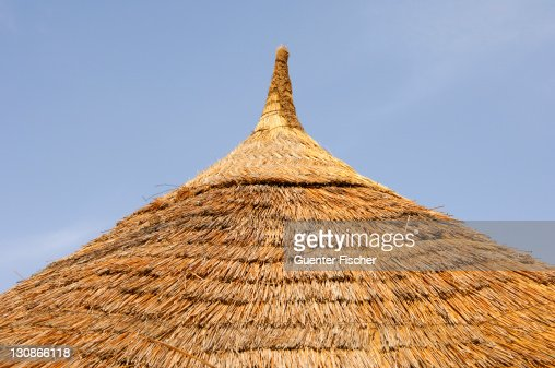Cone-shaped thatched roof of an African round hut, Burkina Faso, West Africa