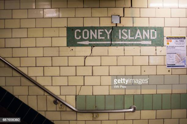 Coney Island sign made of old cracked tile on subway wall in New York New York USA