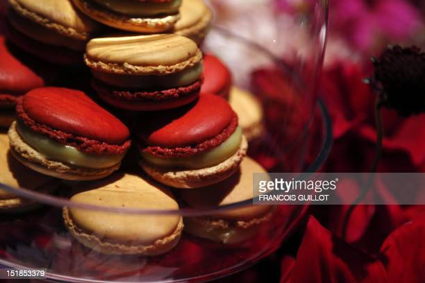 Confectionary 'macaron' made by French pastry chef Pierre Herme are displayed in a showroom during a presentation untitled 'Illusion' on September 12...