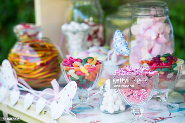 Confectionery in glasses and jars, close-up