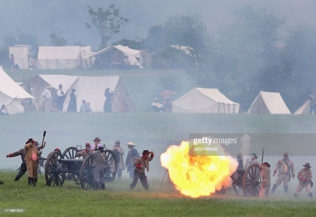 Confederate Civil War re-enactors fire cannon towards Union positions ahead of Pickett's Charge on the last day of a Battle of Gettysburg re-enactment on June 30, 2013 in Gettysburg, Pennsylvania. Some 8,000 re-enactors from the Blue Gray Alliance participated in the event, marking the 150th anniversary of the July 1-3, 1863 Battle of Gettysburg. Confederate General Robert E. Lee's Army of Northern Virginia was routed during the doomed frontal assault, considered the turning point in the Civil War and a watershed moment in U.S. history. Union and Confederate armies suffered a combined total of up to 51,000 casualties over three days, the highest number of any battle in the four-year war. Pickett's charge was named for the Confederate Maj. General George Pickett, whose division of rebel troops was annhilated in the attack.
