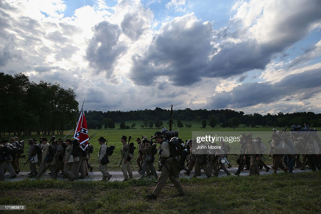 Confederate Civil War re-enactors from Hood's Texas Brigade march into position for an evening attack on Union troops as part of a three-day Battle of Gettysburg re-enactment on June 29, 2013 in Gettysburg, Pennsylvania. Some 8,000 re-enactors from the Blue Gray Alliance are participating in events marking the 150th anniversary of the July 1-3, 1863 Battle of Gettysburg. General Robert E. Lee's Army of Northern Virginia was defeated on the third day of the battle, considered the turning point in the American Civil War and a watershed moment in the nation's history. Union and Confederate armies suffered a combined total of some 46,000-51,000 casualties over three days, the highest of any battle the four-year war.