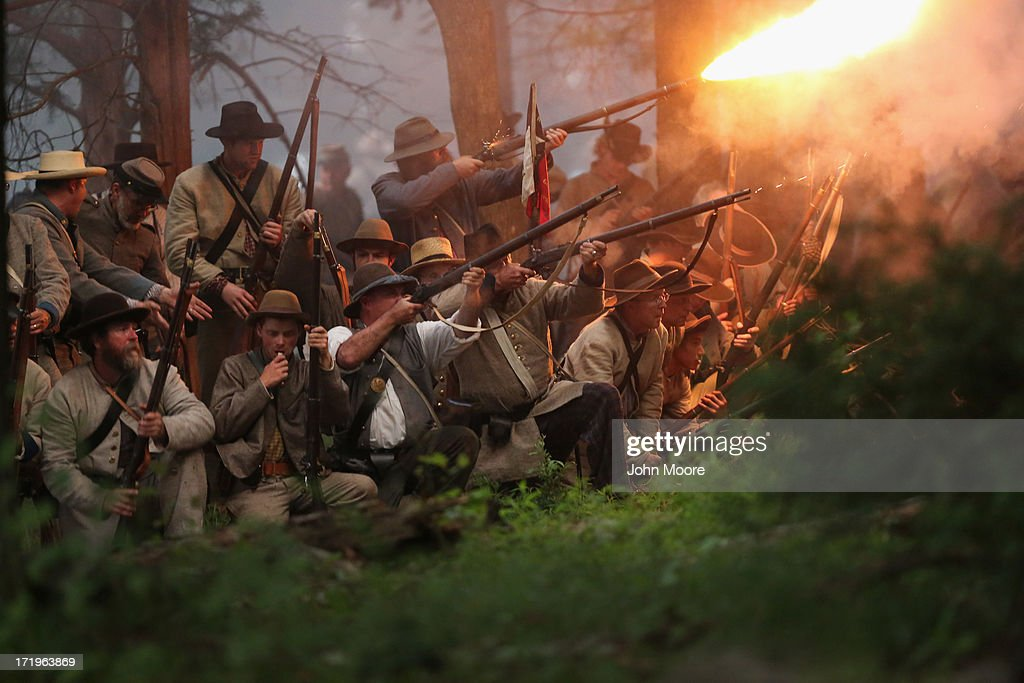 Confederate Civil War re-enactors launch an evening attack during a three-day Battle of Gettysburg re-enactment on June 29, 2013 in Gettysburg, Pennsylvania. Some 8,000 re-enactors from the Blue Gray Alliance are participating in events marking the 150th anniversary of the July 1-3, 1863 Battle of Gettysburg. General Robert E. Lee's Army of Northern Virginia was defeated on the third day of the battle, considered the turning point in the American Civil War and a watershed moment in the nation's history. Union and Confederate armies suffered a combined total of some 46,000-51,000 casualties over three days, the highest of any battle the four-year war.