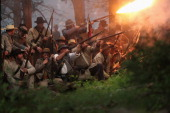 Confederate Civil War reenactors launch an evening attack during a threeday Battle of Gettysburg reenactment on June 29 2013 in Gettysburg...