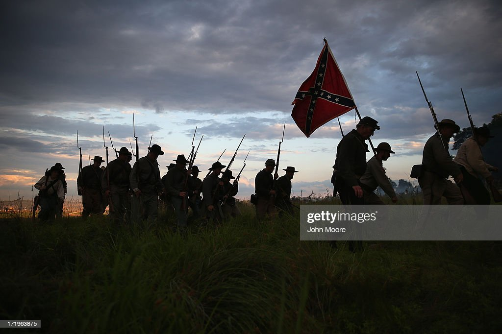 Confederate Civil War re-enactors march for an evening attack during a three-day Battle of Gettysburg re-enactment on June 29, 2013 in Gettysburg, Pennsylvania. Some 8,000 re-enactors from the Blue Gray Alliance are participating in events marking the 150th anniversary of the July 1-3, 1863 Battle of Gettysburg, considered the turning point in the American Civil War. Union and Confederate armies suffered a combined total of some 46,000-51,000 casualties in the battle, the highest of any conflict of the war.