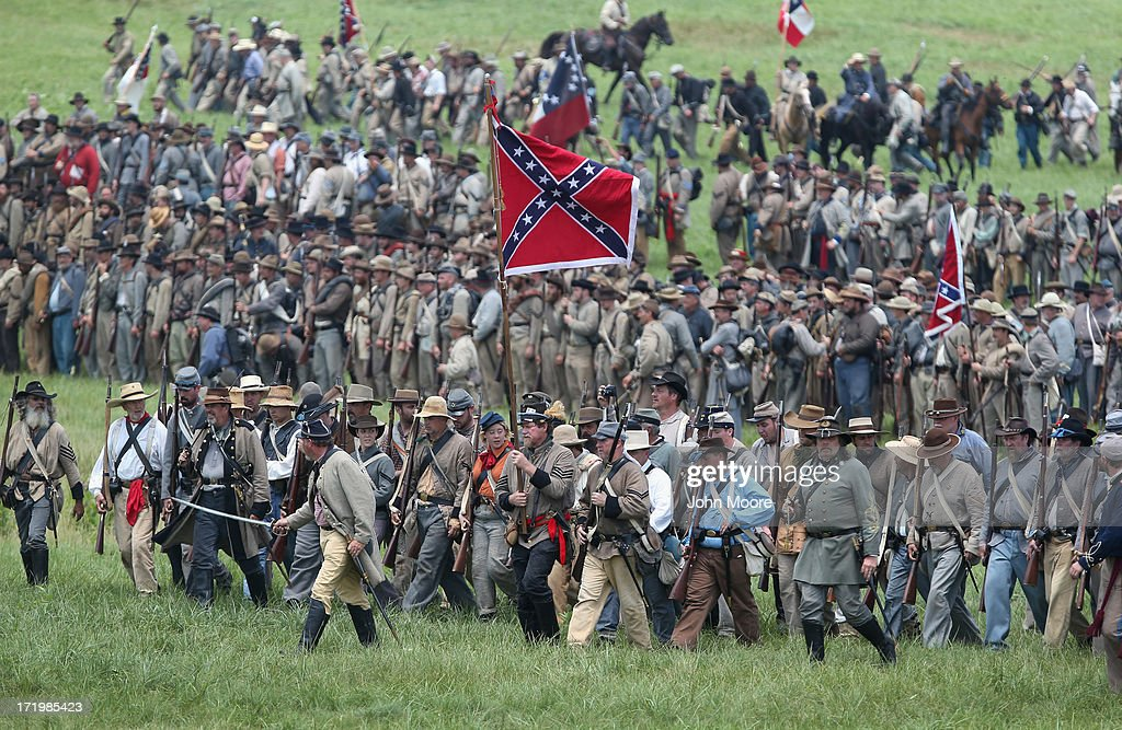 Confederate Civil War re-enactors march towards Union lines during Pickett's Charge on the last day of a Battle of Gettysburg re-enactment on June 30, 2013 in Gettysburg, Pennsylvania. Some 8,000 re-enactors from the Blue Gray Alliance participated in the event, marking the 150th anniversary of the July 1-3, 1863 Battle of Gettysburg. Confederate General Robert E. Lee's Army of Northern Virginia was routed during the doomed frontal assault, considered the turning point in the Civil War and a watershed moment in U.S. history. Union and Confederate armies suffered a combined total of up to 51,000 casualties over three days, the highest number of any battle in the four-year war. Pickett's charge was named for the Confederate Maj. General George Pickett, whose division of rebel troops was annhilated in the attack.