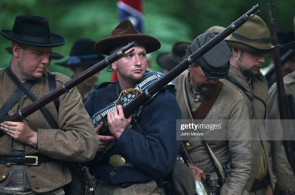 Confederate Civil War re-enactors prepare to stage an attack on the 150th anniversary of the historic Battle of Gettysburg on July 2, 2013 in Gettysburg, Pennsylvania. The historic battle, which took place July 1-3, 1863, is widely considered the turning point in the American Civil War in favor of the Union. Federal and Confederate armies suffered a combined total of 51,000 casualties over three days, the highest number of any battle in the four-year war.