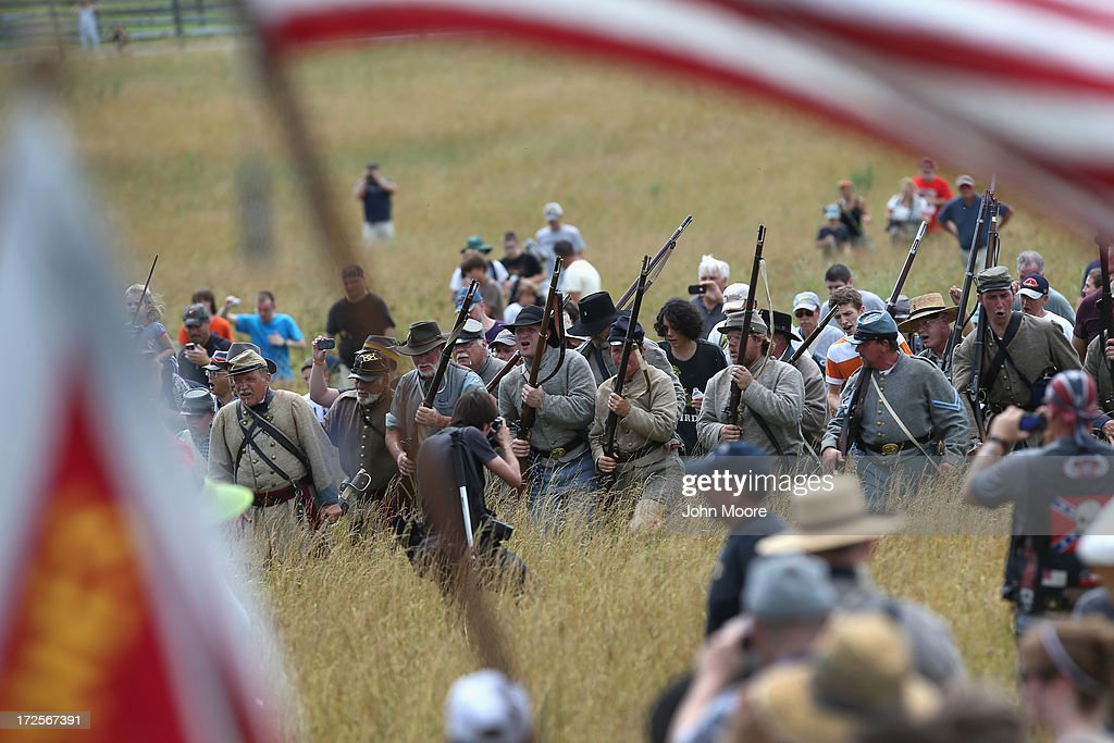 Confederate Civil War re-enactors surge forward as they and thousands of civilians re-enact Pickett's Charge on the 150th anniversary of the historic Battle of Gettysburg on July 3, 2013 in Gettysburg, Pennsylvania . The Rebel charge, which occurred on July 3, 1863, the last day of the three-day battle, was a decisive Union victory and widely considered the turning point in the American Civil War. Federal and Confederate armies suffered a combined total of 51,000 casualties over three days, the highest number of any battle in the four-year war.