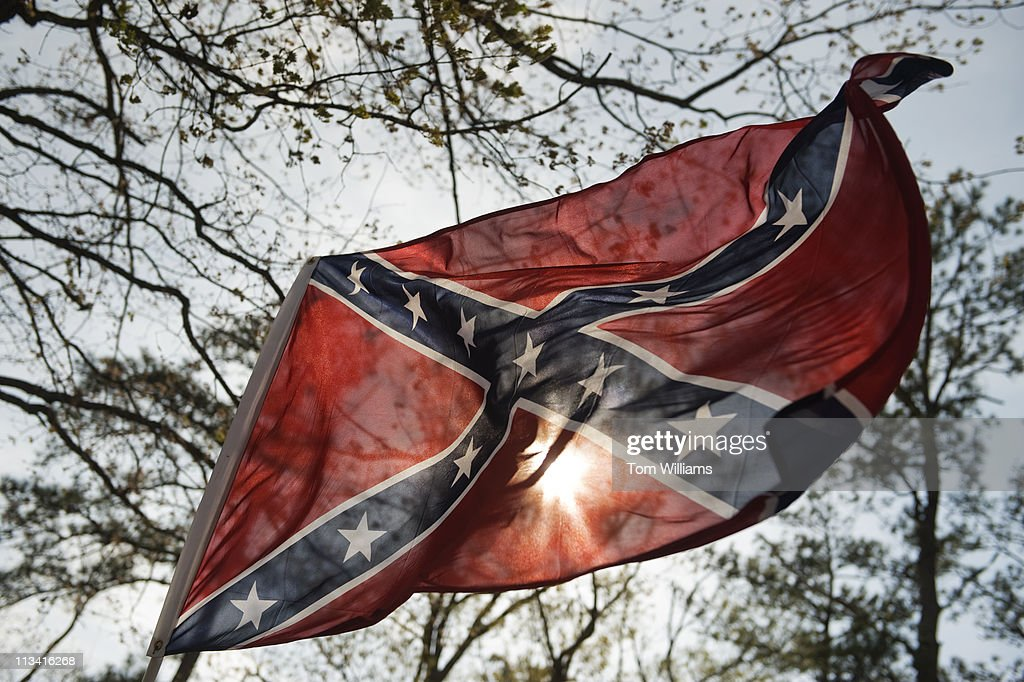 A confederate flag is held by an attendee of the 63rd Annual Shad Planking political rally in Wakefield, Va. Gov. Bob McDonnell, R-Va., was the keynote speaker at the event.