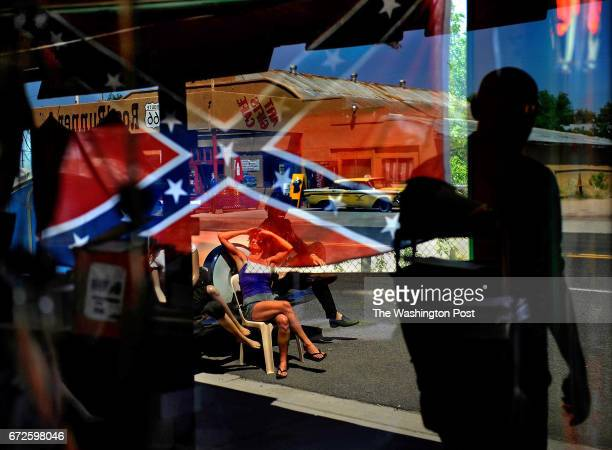 A confederate flag reflected in the window of a gift shop that sells them in Seligman Arizona The Confederate flag can be seen in plain view in...
