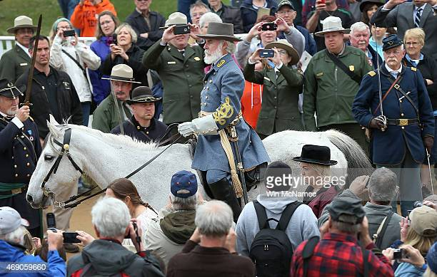 Confederate General Robert E Lee portrayed by American Civil War reenactor Thomas Lee Jessee rides through a crowd of spectators after a reenactment...