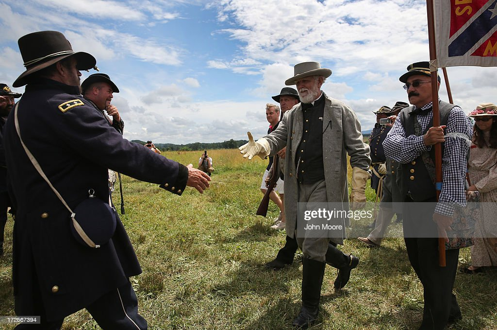 A Confederate General Robert E. Lee re-enactor greets a Union re-enactor following Pickett's Charge on the 150th anniversary of the historic Battle of Gettysburg on July 3, 2013 in Gettysburg, Pennsylvania . The Rebel charge, which occurred on July 3, 1863, the last day of the historic battle, was a decisive Union victory and widely considered the turning point in the American Civil War. Federal and Confederate armies suffered a combined total of 51,000 casualties over three days, the highest number of any battle in the four-year war.