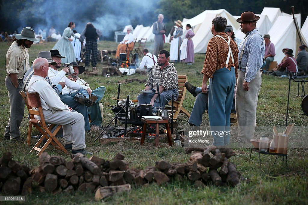 Confederate infantry re-enactors eat supper at their camp during an event to mark the 150th anniversary of the Battle of Antietam September 15, 2012 in Sharpsburg, Maryland. The Battle of Antietam was fought on September 17, 1862 and was the bloodiest battle in American history with more than 23,000 men killed, wounded, and missing in one single day. It marked the end of General Robert E. Lee's first invasion of the North and led to Abraham Lincoln's issuance of the Emancipation Proclamation.