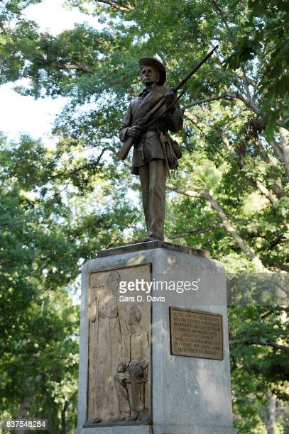 A Confederate statue coined Silent Sam is guarded by two layers of fence chain and police on the campus of the University of Chapel Hill on August 22...