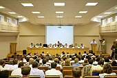 Conference audience attending a videotaped panel discussion