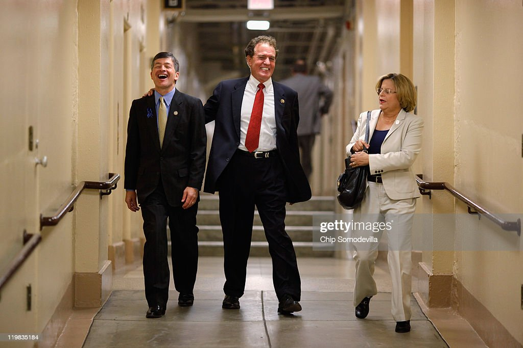 GOP Conference Chair Jeb Hensarling (R-TX), U.S. Rep. Phil Gingrey (R-GA), U.S. Rep. <a gi-track='captionPersonalityLinkClicked' href=/galleries/search?phrase=Ileana+Ros-Lehtinen&family=editorial&specificpeople=588095 ng-click='$event.stopPropagation()'>Ileana Ros-Lehtinen</a> (R-FL) head to a Republican conference meeting in the basement of the U.S. Capitol July 25, 2011 in Washington, DC. Both Democrats and Republicans in the House and Senate have started the week with a series of caucus meetings to talk about the ongoing budget and debt ceiling negotiations.