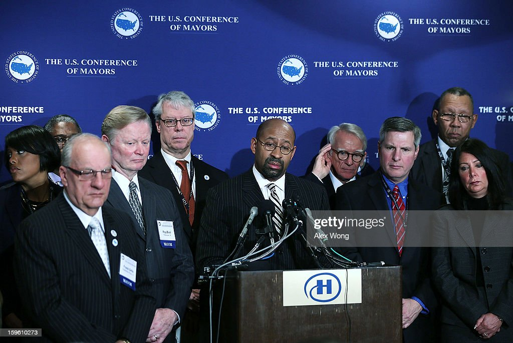 U.S. Conference of Mayors President and Mayor of Philadelphia <a gi-track='captionPersonalityLinkClicked' href=/galleries/search?phrase=Michael+Nutter&family=editorial&specificpeople=4695146 ng-click='$event.stopPropagation()'>Michael Nutter</a> (C) listens to a question from the press withother members of the U.S. Conference of Mayors during a news conference at the 81st Winter Meeting of the USCM at Capital Hilton Hotel January 17, 2013 in Washington, DC. The meeting will focus on various topics including job creation, fiscal cliff agreement and sequestration, gun control, threat to tax-exempt financing, Suprestorm Sandy response and immigration.