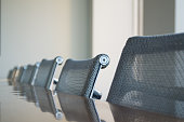 Modern conference room chairs and table shot with a shallow depth of field.