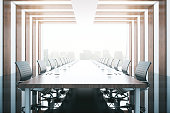 Side view of wooden table and chairs in modern conference room with city view. 3D Rendering