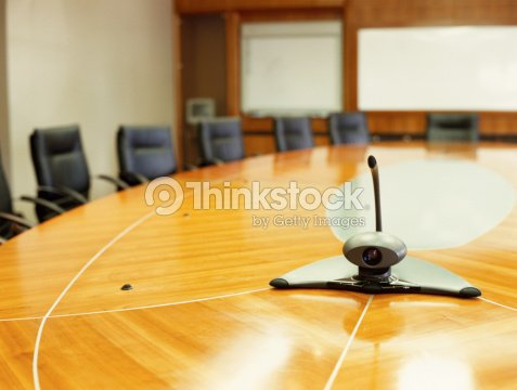 Conference Room With A Video Conference Camera On A Table In An ...