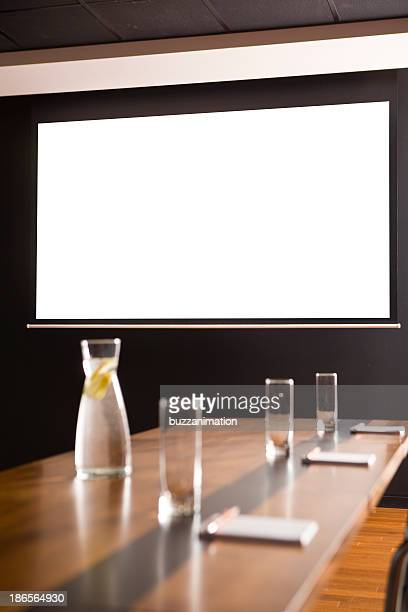 Conference room with a white screen