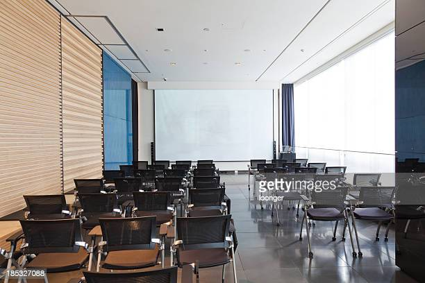 conference room with chairs and projection screen